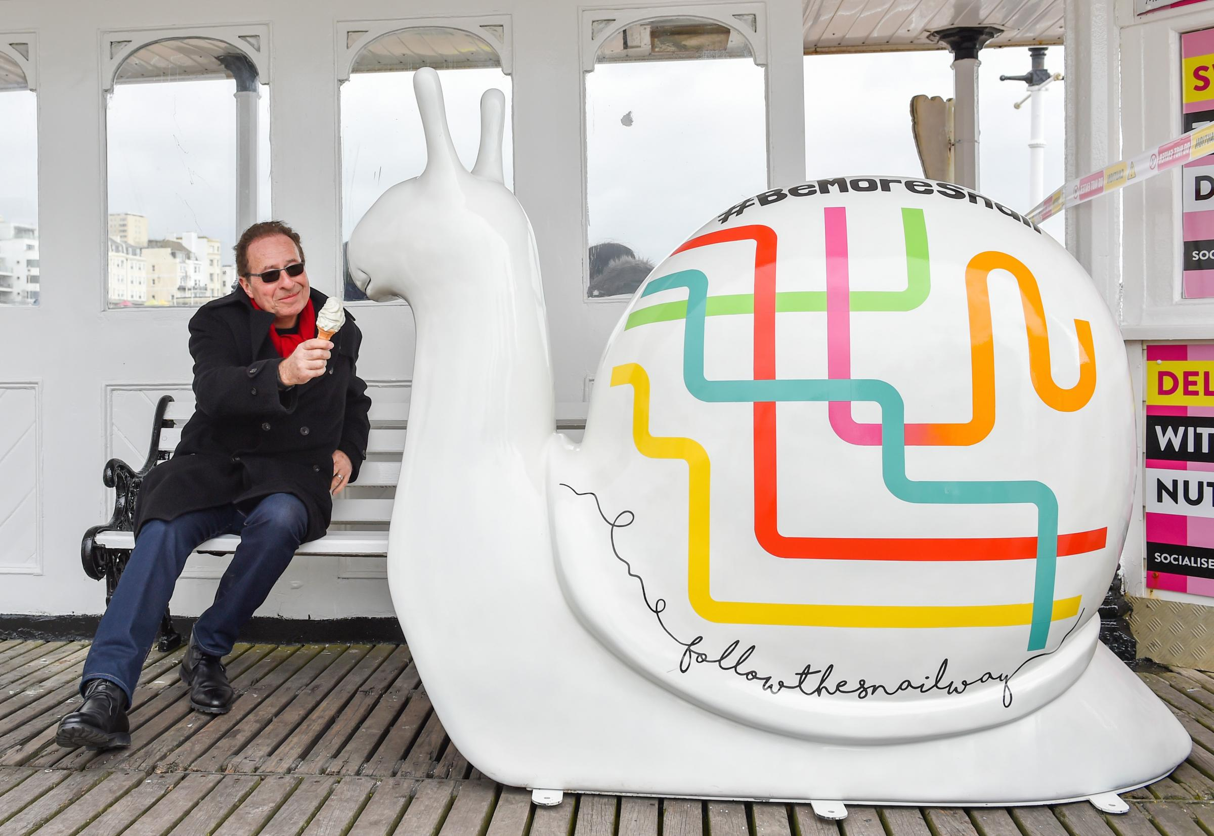 Peter James with 'Geo' giant snail.Photograph taken by Simon Dack / Vervate