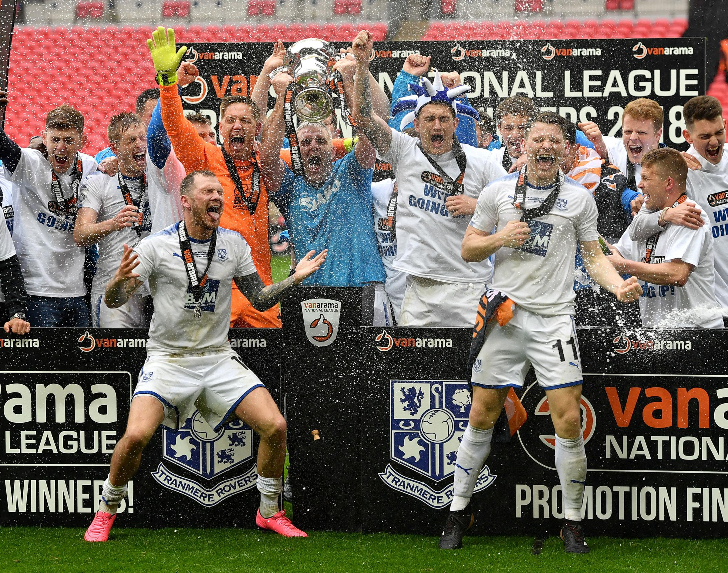 James Norwood, front of picture to the left, enjoys the Wembley celebrations