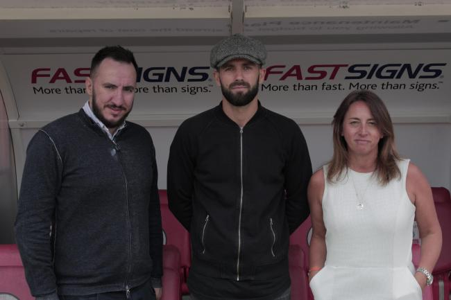 Director of Football Selim Gaygusuz and Operations Director Kelly Derham with George Francomb. Picture: CTFC