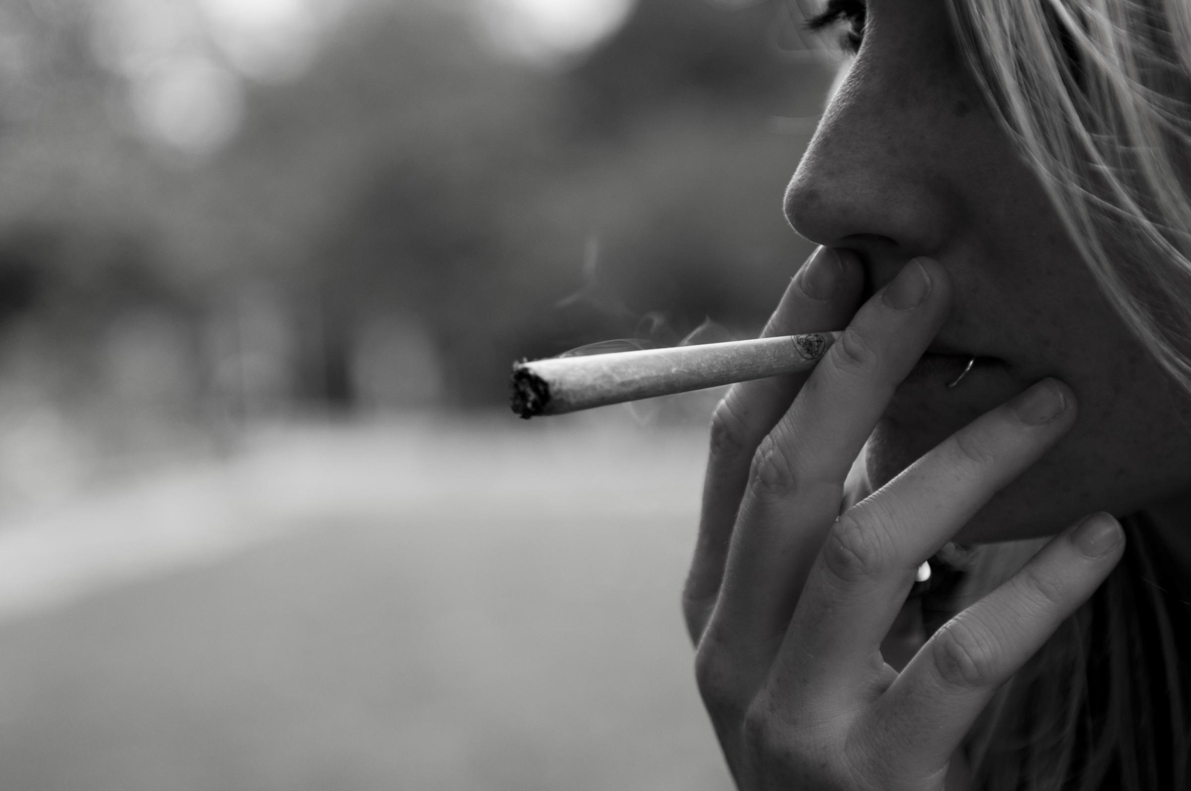 A woman smoking cannabis (stock photo) This file is licensed under the Creative Commons Attribution 2.0 Generic license..