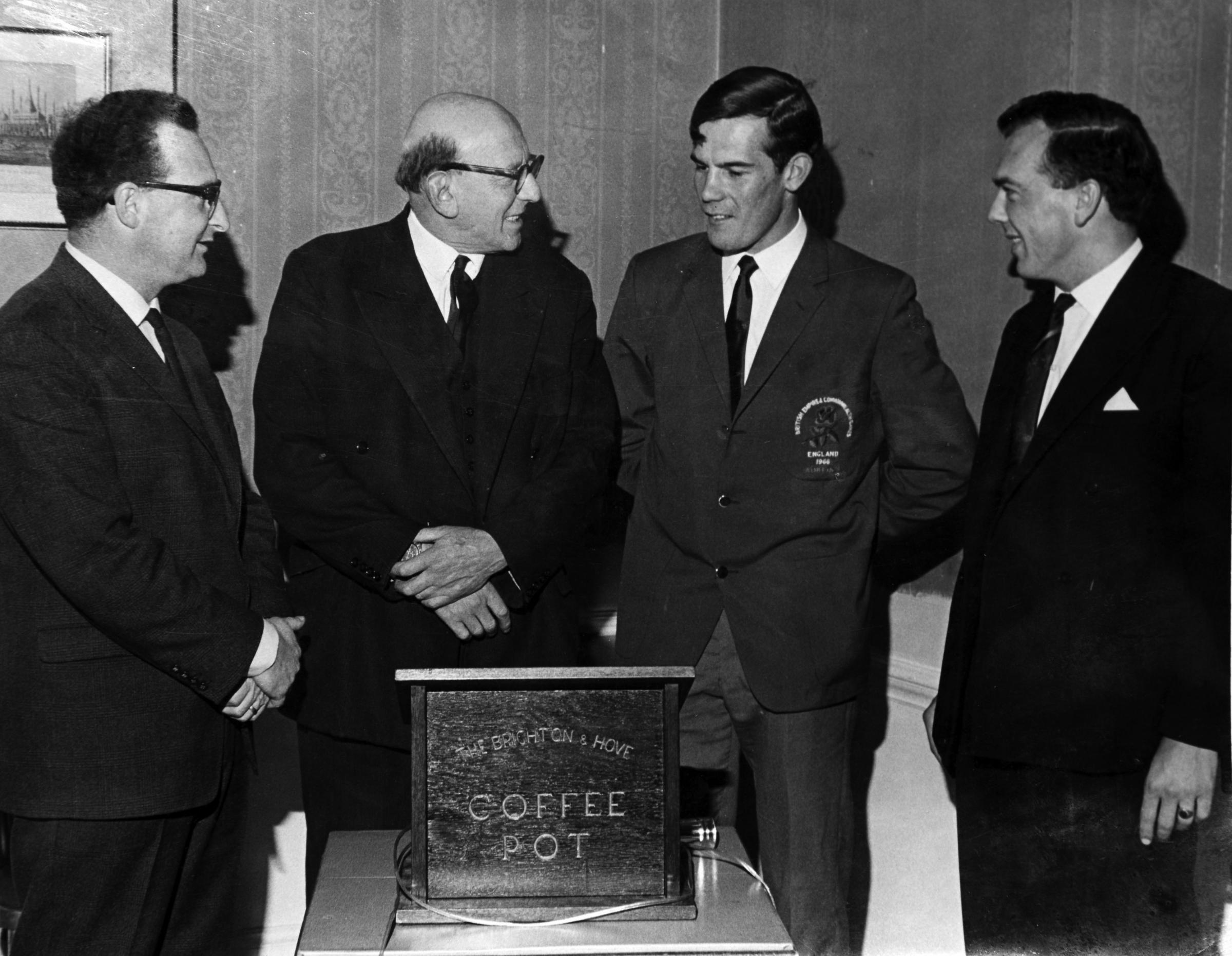 (l-r) Brian Joseph-Horen, Chairman, Sir Harold Abrahams CBE MA LL.B, Chris Carter and David Rutter Programme Secretary. .Picture taken in 9th Nov 1966, double Olympic champion Chris Carter guest at Brighton and Hove Coffee Pot Club..