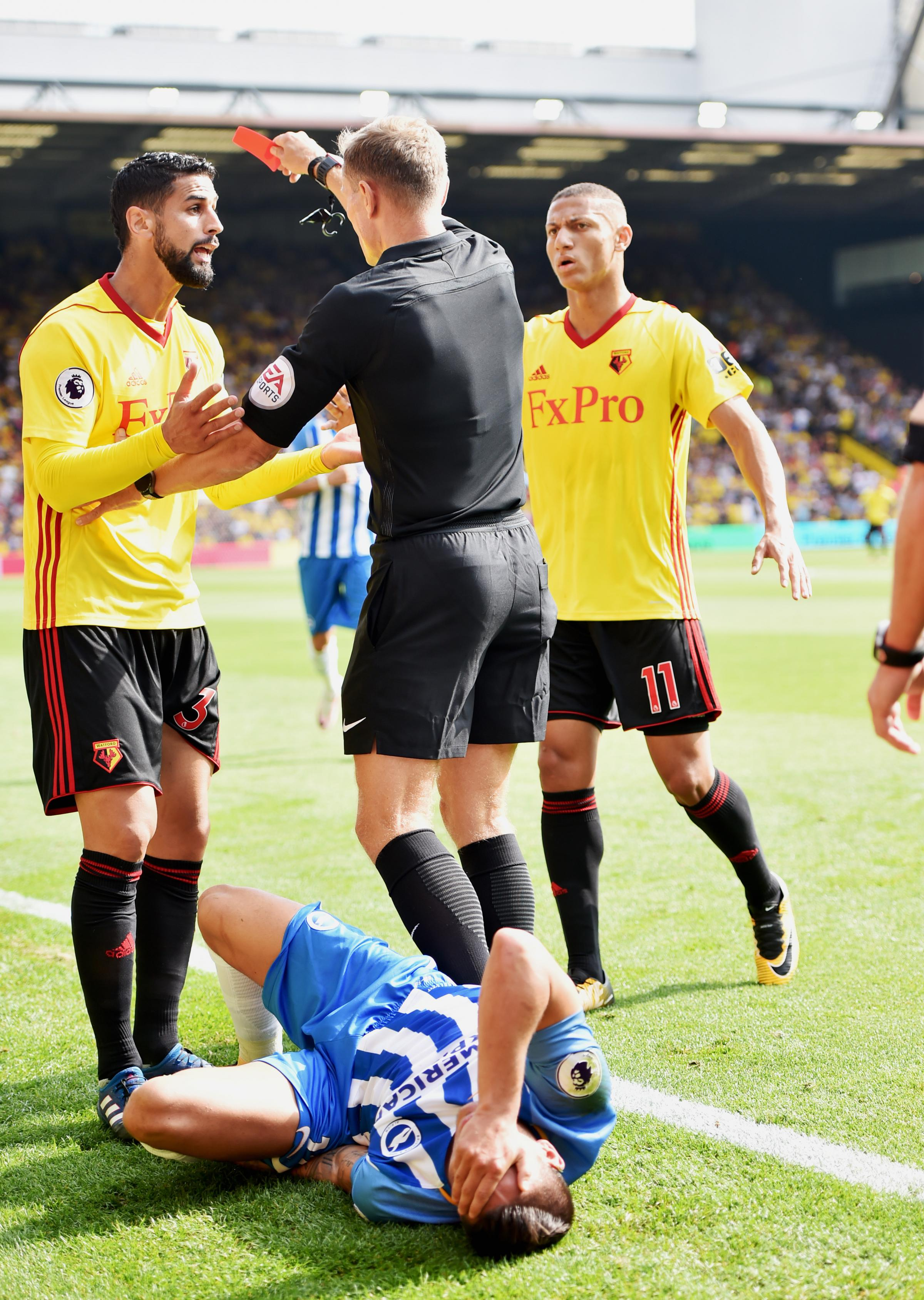 Watford's Miguel Britos (left) is sent-off last season after an awful tackle on Albion winger Anthony Knockaert