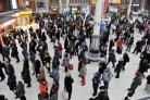 File photo dated 18/01/13 of travellers waiting for their trains. Delays getting train drivers to work by taxi caused fresh disruption on Wednesday, continuing a week of misery for rail passengers. PRESS ASSOCIATION Photo. Issue date: Wednesday June 27, 2