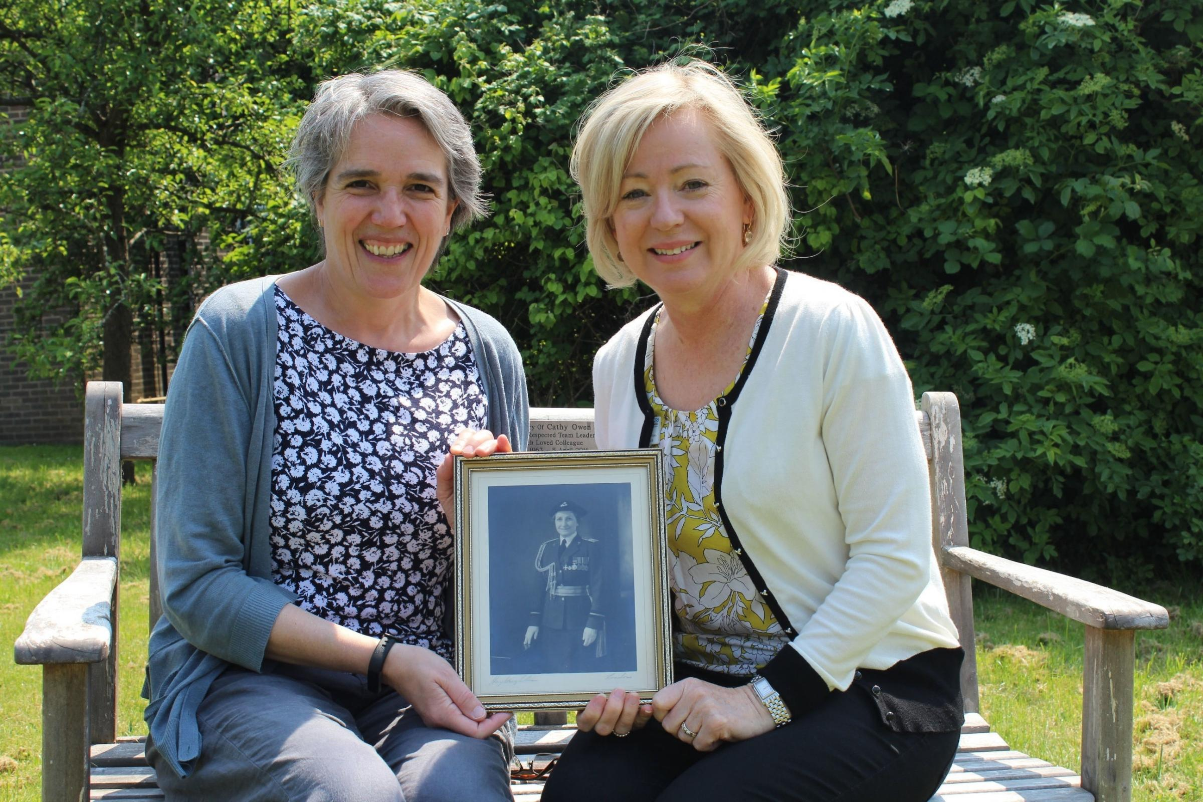 Undated handout photo issued by Sussex Partnership NHS Foundation Trust of Joanna Norcross (left) and Doctor Anita Green holding a picture of their mutual relation Dame Alice Mary Williamson who worked in the Princess Mary's Royal Air Force Nursing Se