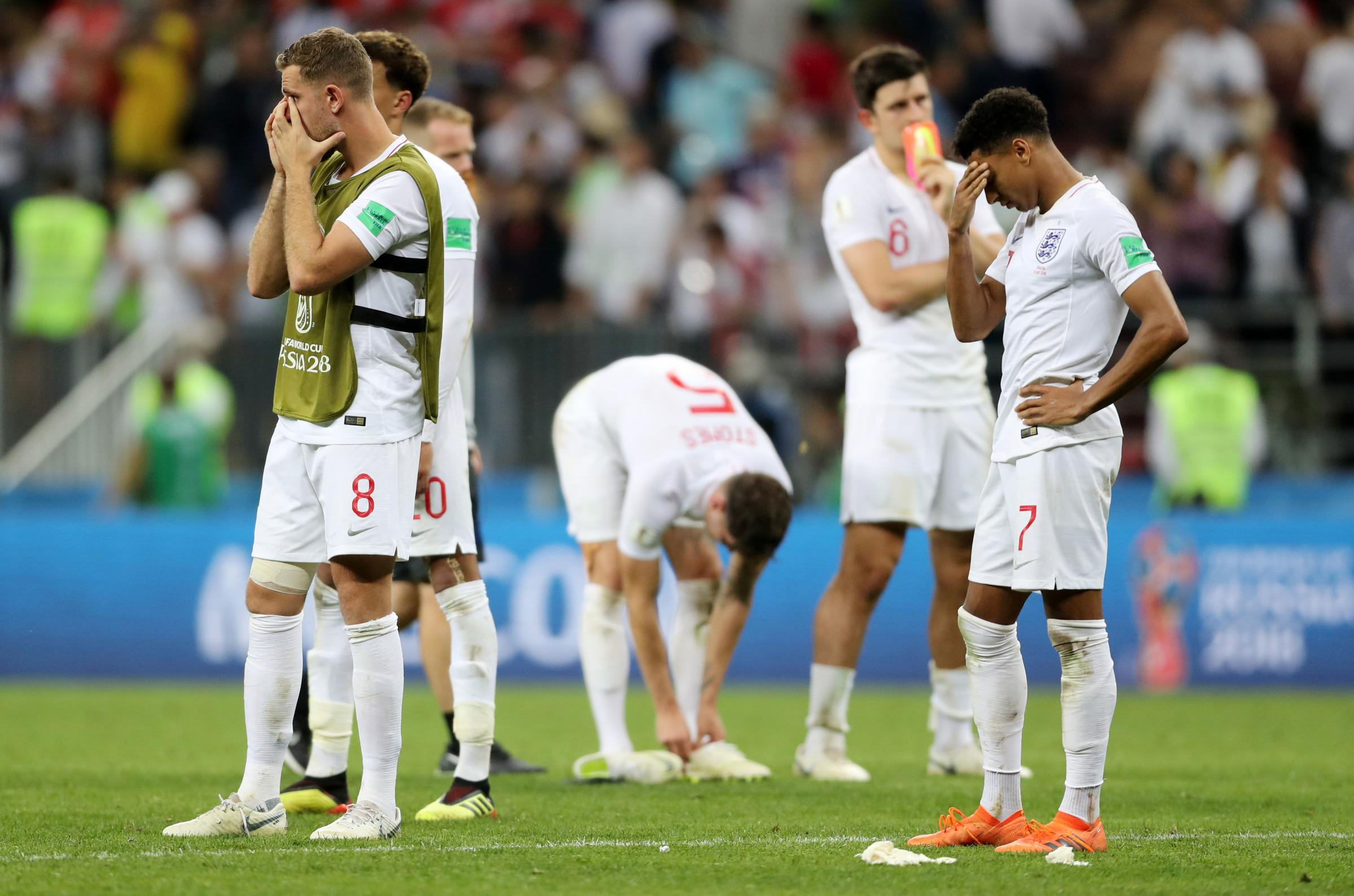 Former Albion loan signing Jesse Lingard (right) looks dejected after England's defeat