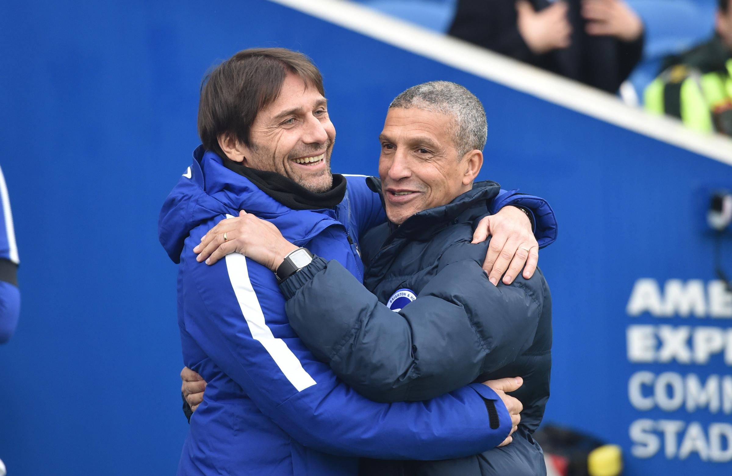 Albion boss Chris Hughton (right) will not be welcoming Antonio Conte (left) back to the Amex this season.