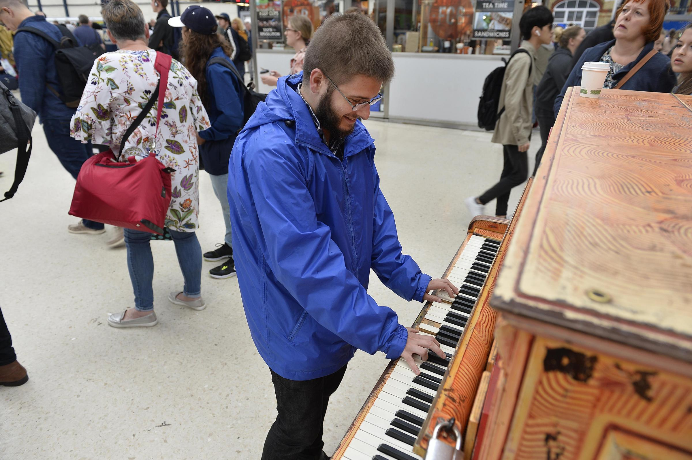 A piano on the concourse of Brighton Railway Station is there for passengers to play.Matthew Baillie (crt) of Hassocks at the keyboard  (Did not want to give contact number)