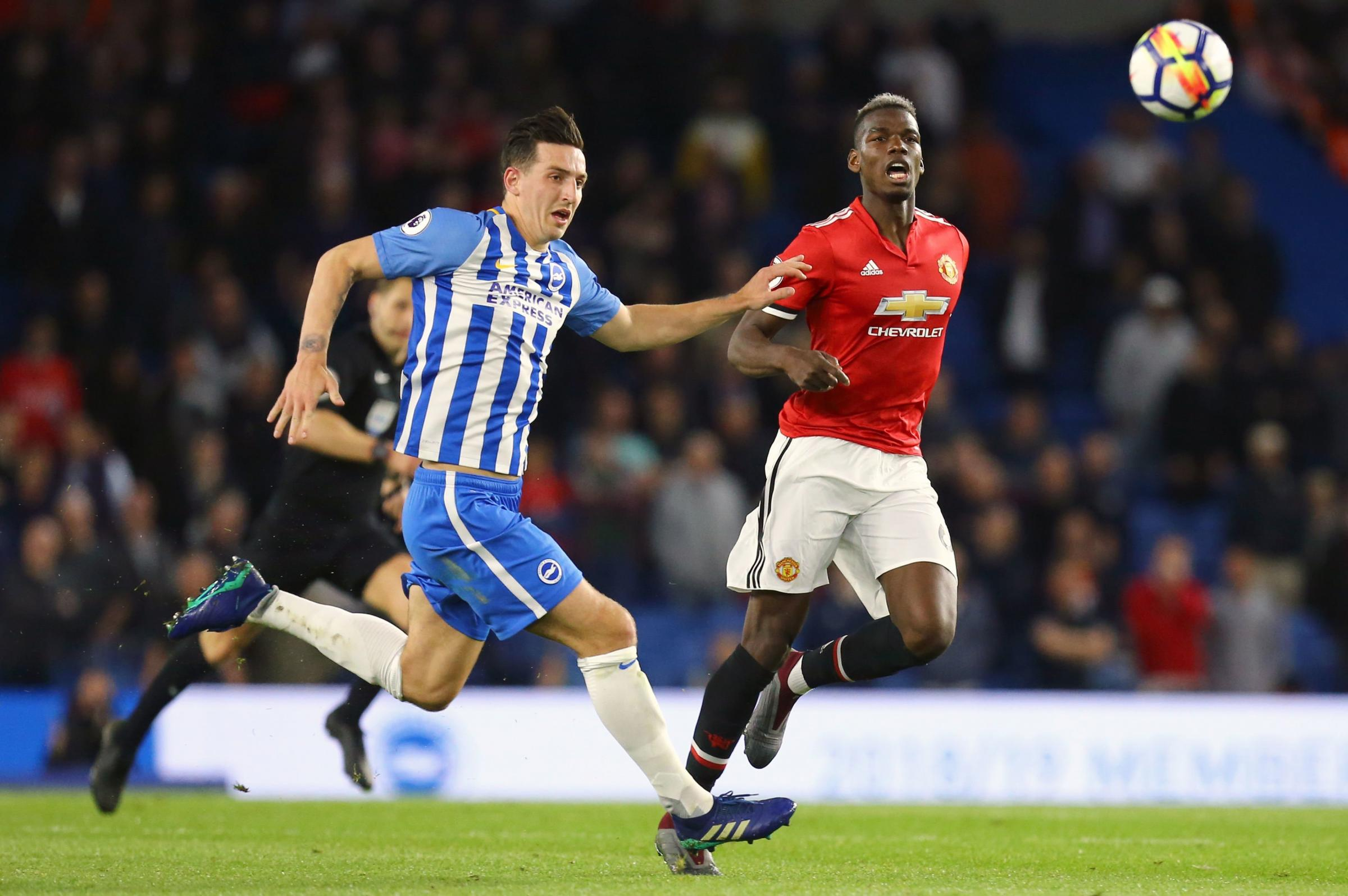 Brighton & Hove Albion's Lewis Dunk (left) and Manchester United's Paul Pogba battle for the ball during the Premier League match at the AMEX Stadium, Brighton. PRESS ASSOCIATION Photo. Picture date: Friday May 4, 2018. See PA story SOCCER Brighto