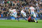 Shane Duffy (far left) is chased by jubilant team-mates as he celebrates his first Premier League goal for Albion. Pictures Liz Finlayson and Simon Dack