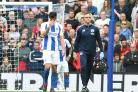 Lewis Dunk leaves the field against Manchester United