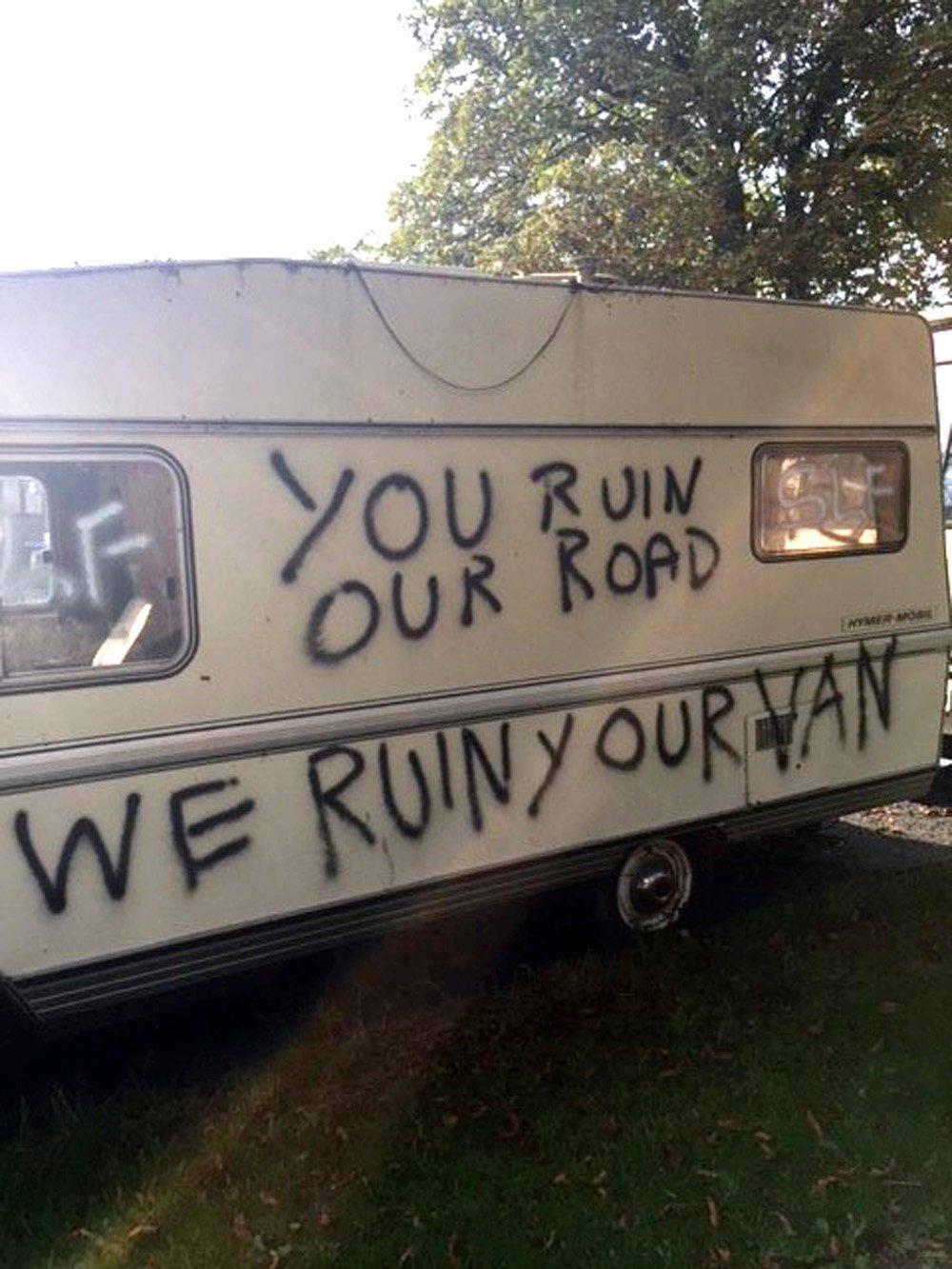 740708ceae Surrenden Road parking row  Vandals spray rude graffiti over vans ...
