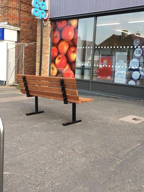 Bench outside Co-op in The Parade in Hangleton