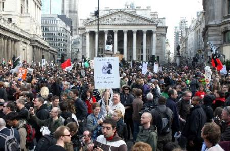 The crowd hold up placards outside the Bank of England
