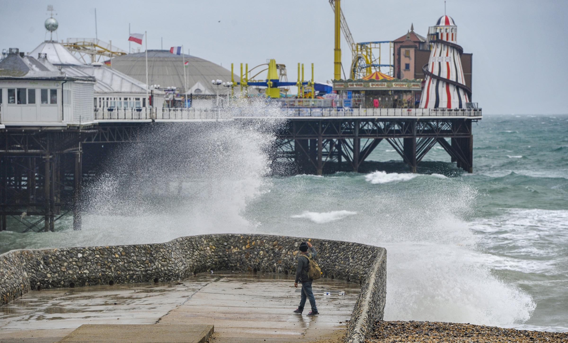 Brighton UK 18th September 2018 - Waves crash on to Brighton seafront as Storm Helene starts to hit Britain with winds of up to 70 mph expected in some parts of the UK over the next few days..