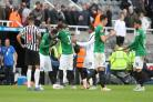 Albion players celebrate a precious away win at Newcastle. Pictures Richard Parkes