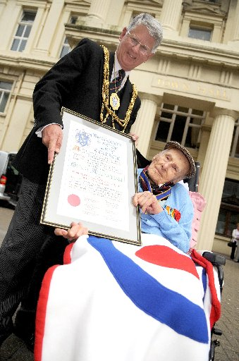 FREEMAN: Henry Allingham gets the freedom of the City of Brighton and Hove from Mayor Garry Peltzer Dunn outside Brighton Town Hall