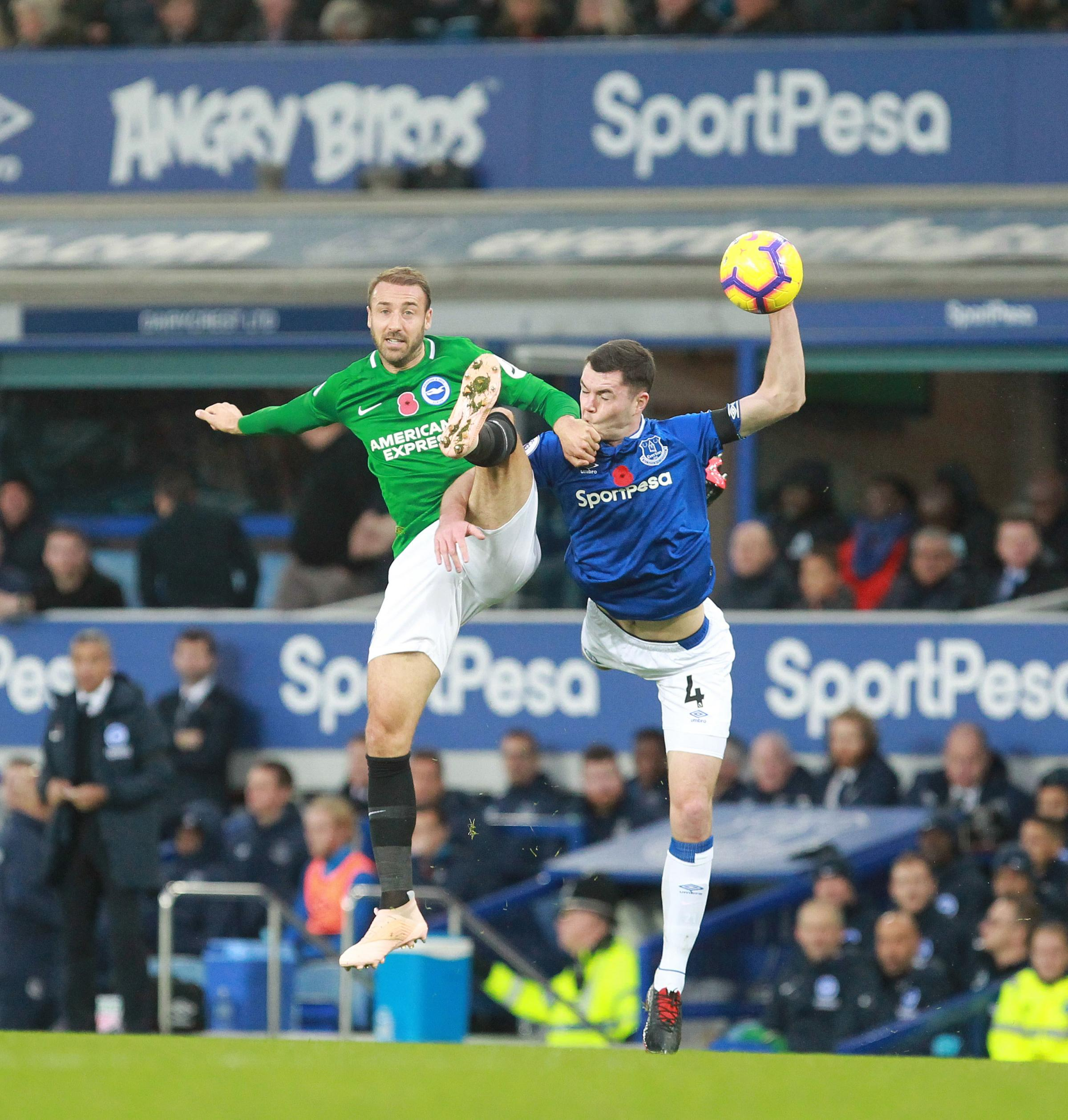Glenn Murray tussles with Everton's Michael Keane last weekend