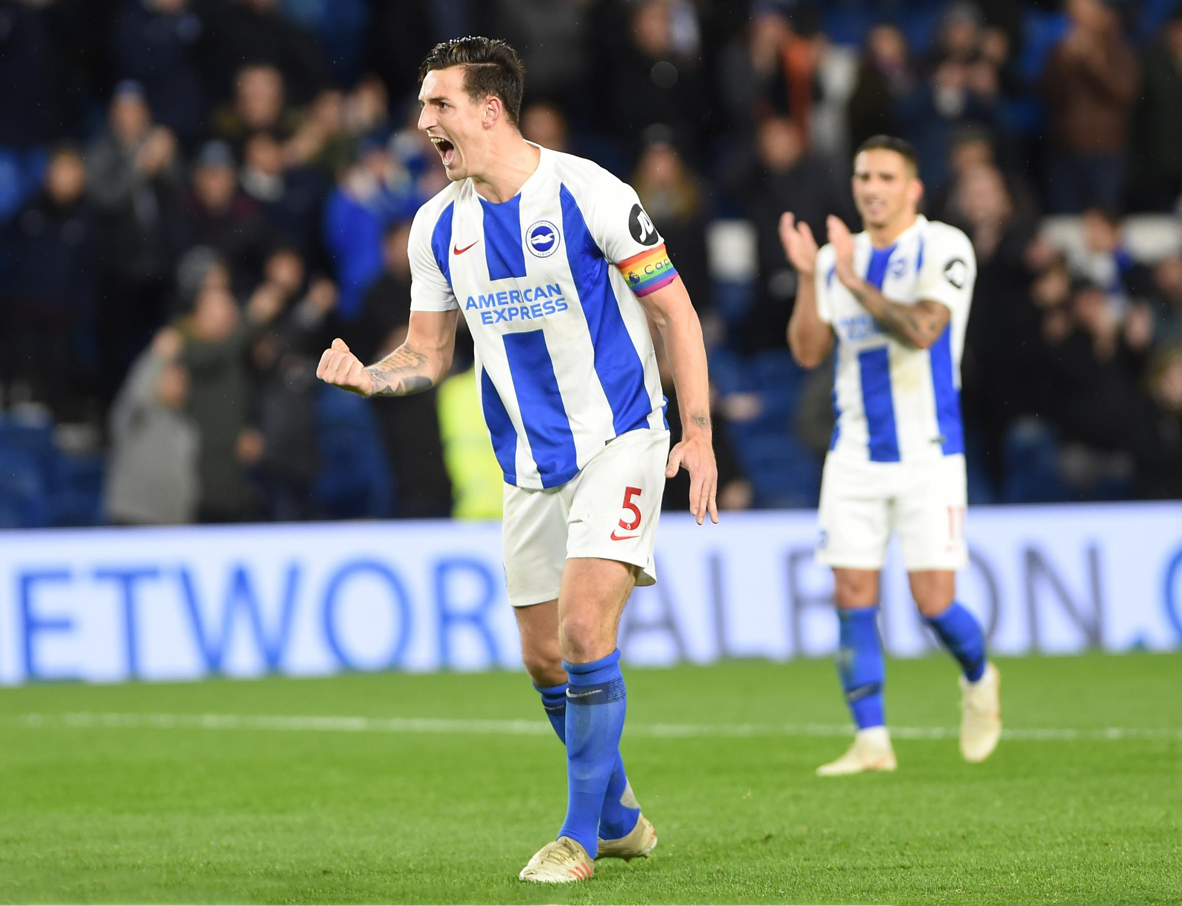 Lewis Dunk leads the post-match celebrations