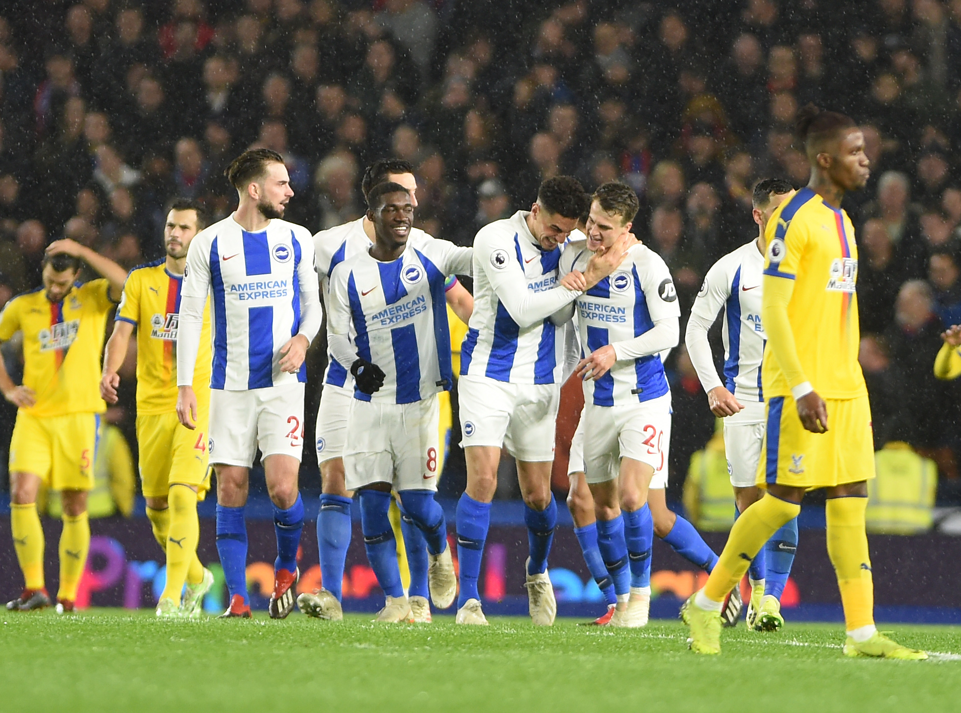 Solly March (third right) is congratulated by Leon Balogun after supplying his goal from a corner against Crystal Palace