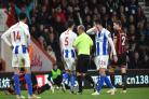 Lewis Dunk (No.5) was sent-off for the first time since February 2017 by Mike Dean (centre)