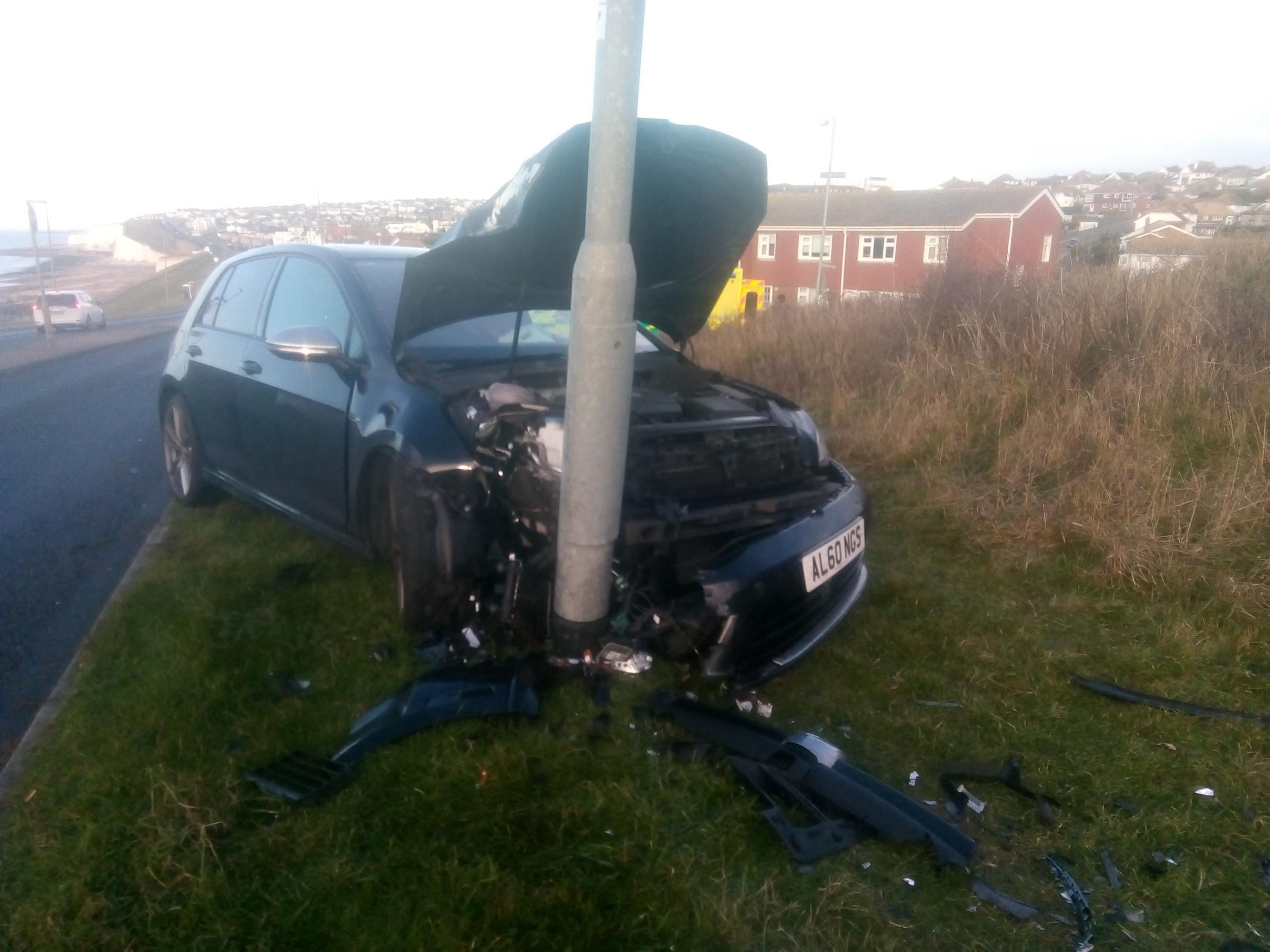 Car smashes into lamppost on A259: police and ambulance on the scene