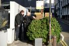 Police search bushes in Charles Street, Brighton.