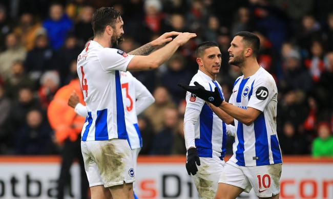 Shane Duffy celebrates with Florin Andone after they combined for Albion's third goal at Bournemouth