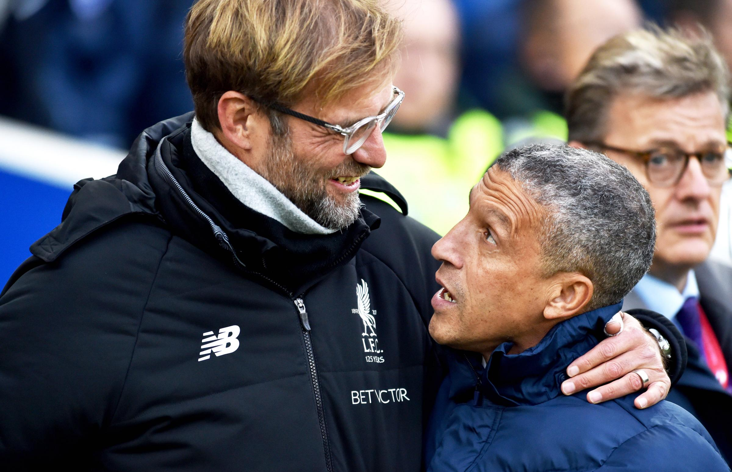 Chris Hughton (right) and Jurgen Klopp (left)