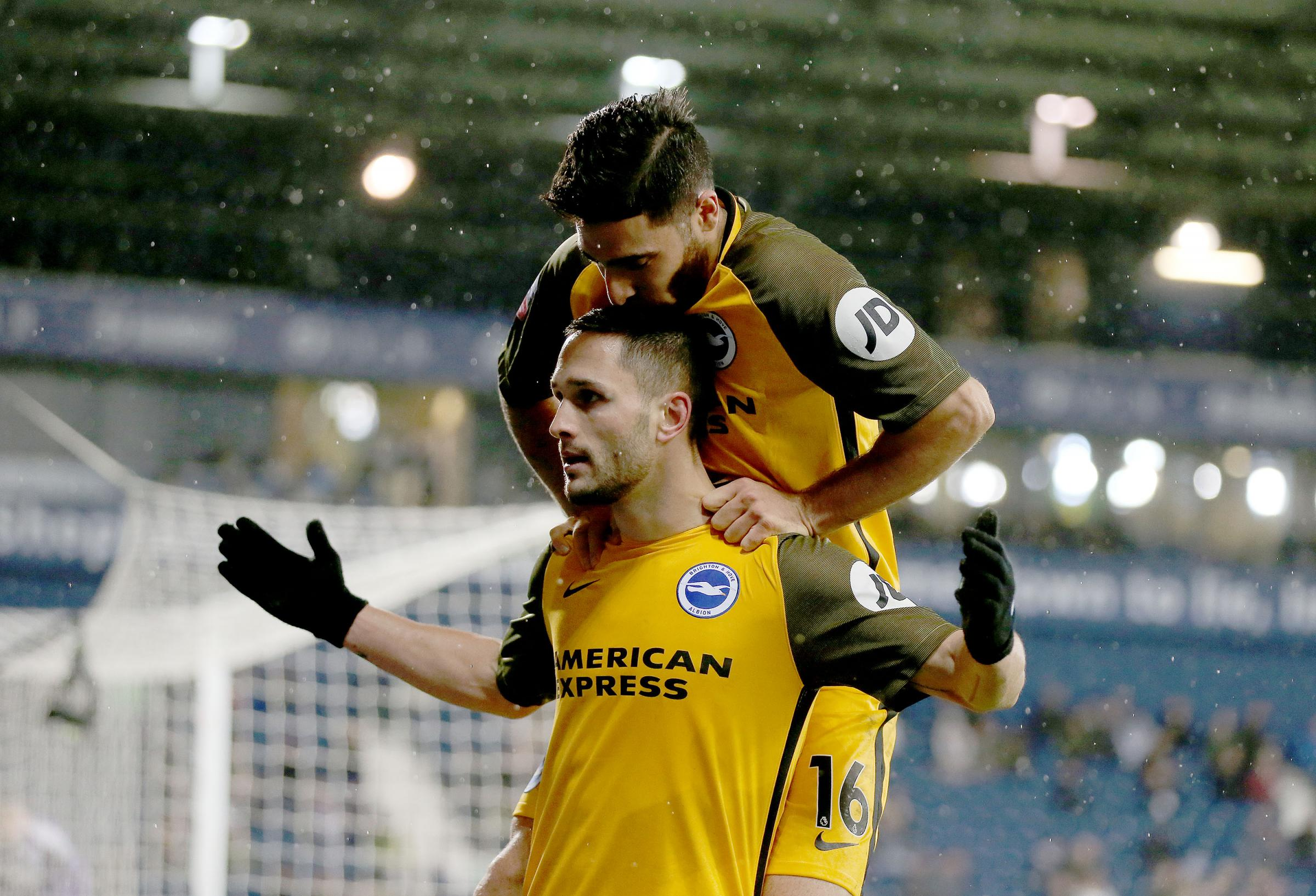 The banned Florin Andone celebrates his equaliser at West Brom with Alireza Jahanbakhsh. Picture Richard Parkes.