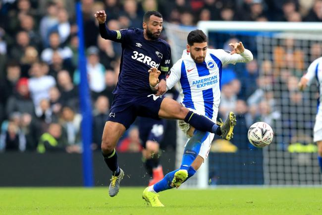 Derby County's Ashley Cole (left) and Brighton & Hove Albion's Alireza Jahanbakhsh battle for the ball during the FA Cup fifth round match at the AMEX Stadium, Brighton. PRESS ASSOCIATION Photo. Picture date: Saturday February 16, 2019. See PA