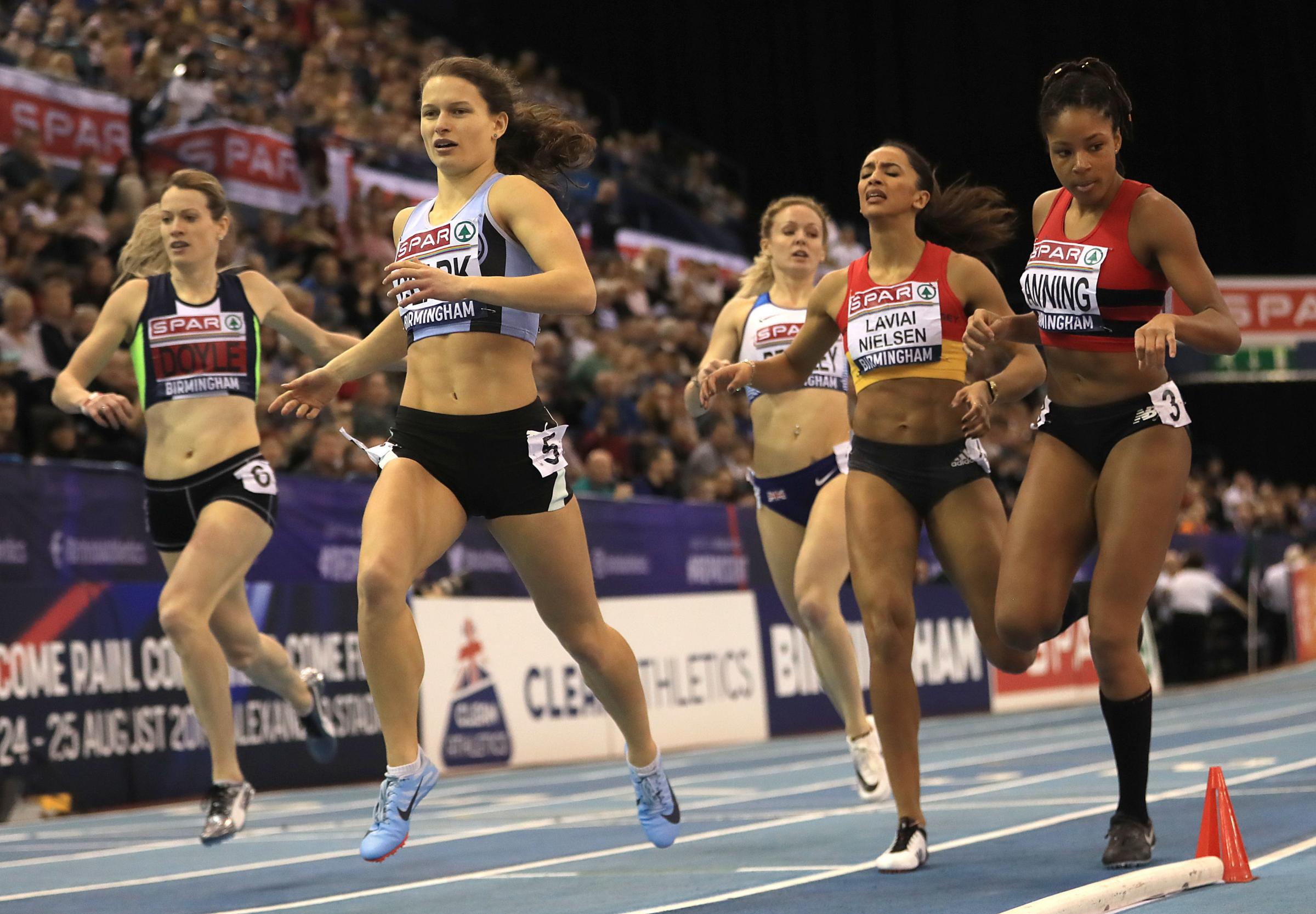 Amber Anning (right) breaking the British women's under-20 400 metres record which had stood since 1970