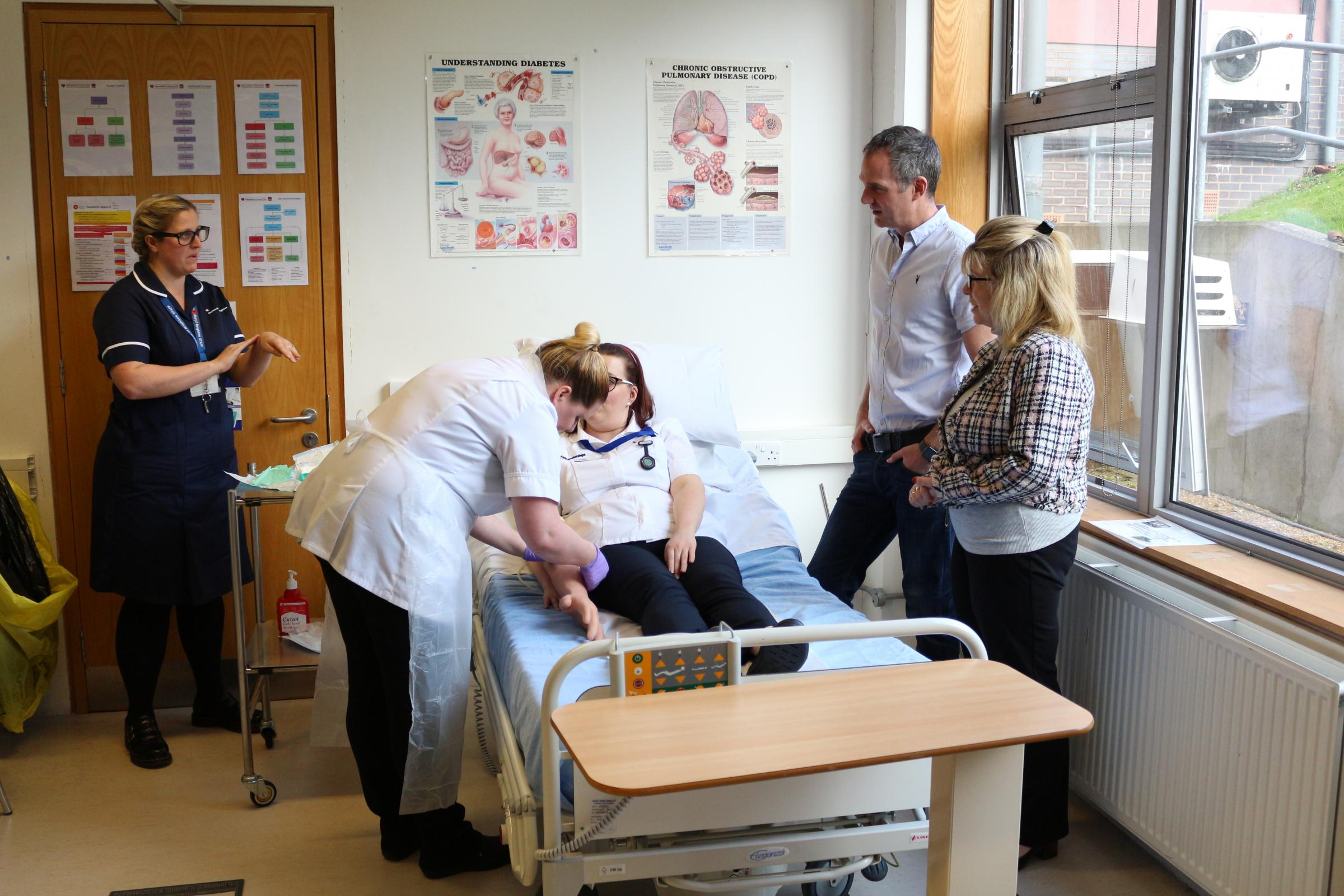MPs Peter Kyle and Maria Caulfield observe an 'Aseptic Non Touch Technique'