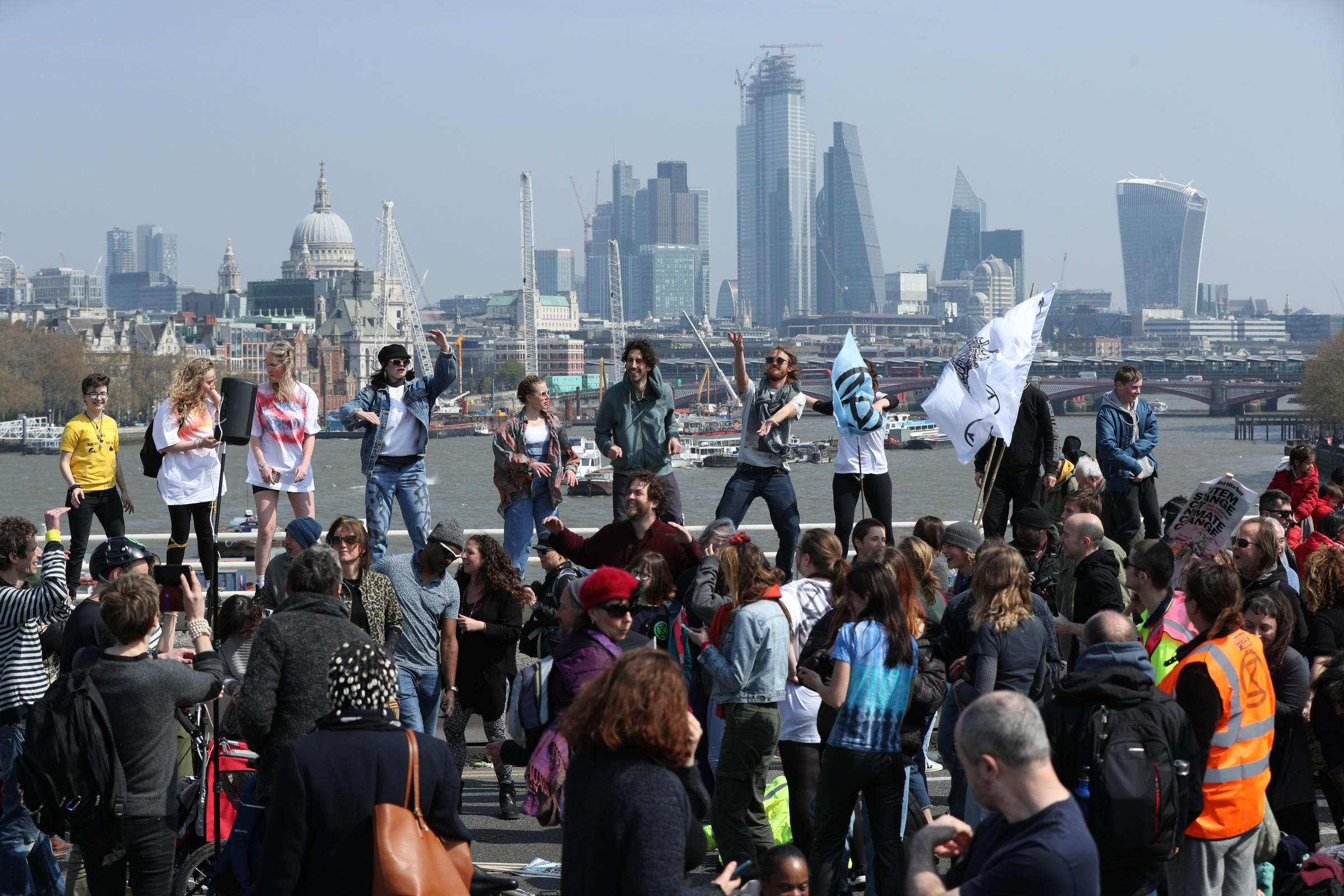Demonstrators during an Extinction Rebellion protest on Waterloo Bridge in London