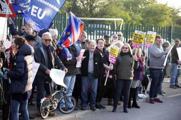 The Argus: Protesters gather outside a rally held by Brexit Party leader Nigel Farage at Shoreham Airport