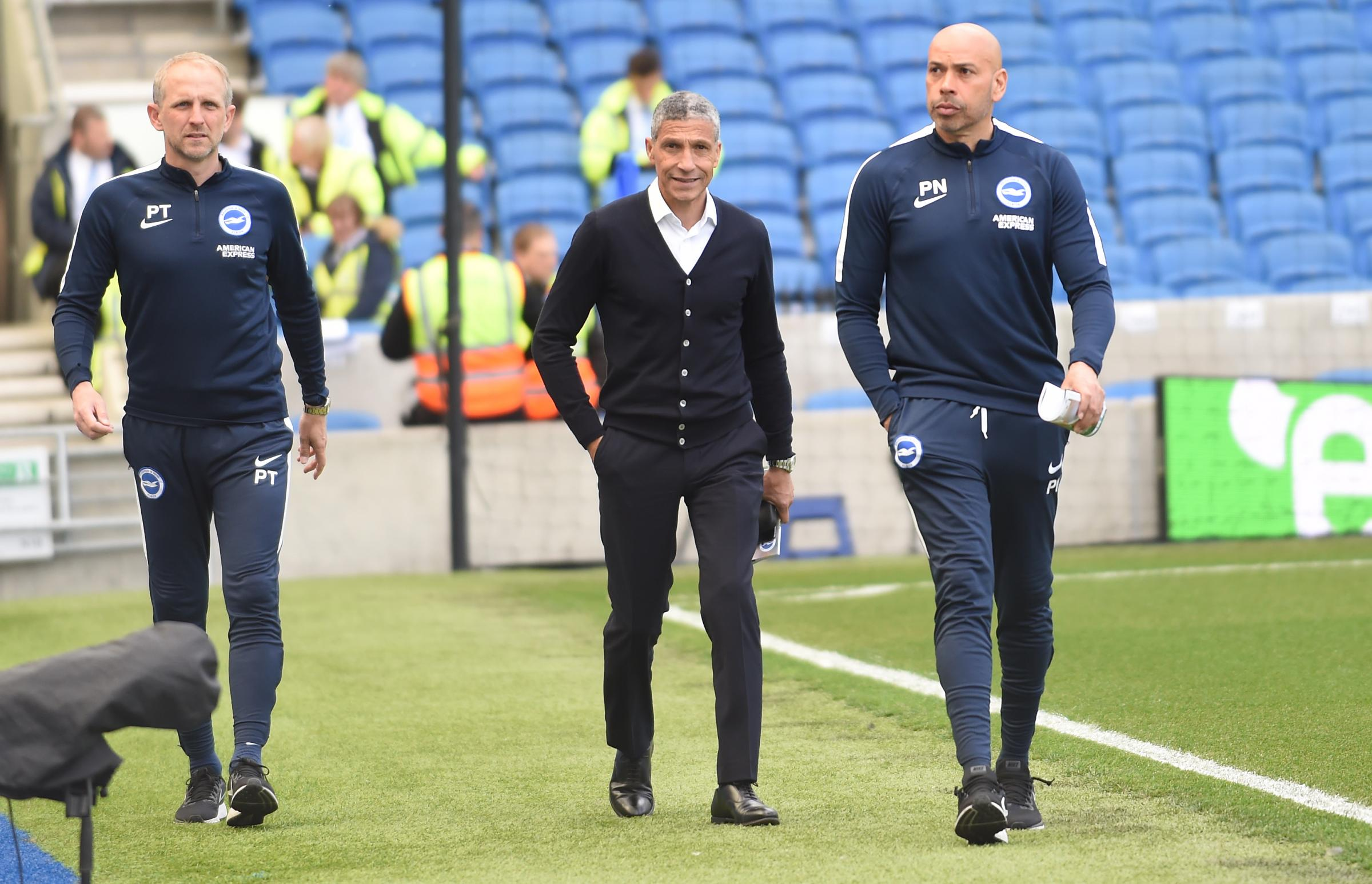 Chris Hughton and his management team at the Amex
