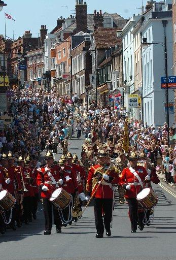 Thousands of wellwishers lined the streets of an historic town today to cheer soldiers recently returned from Afghanistan and Iraq.