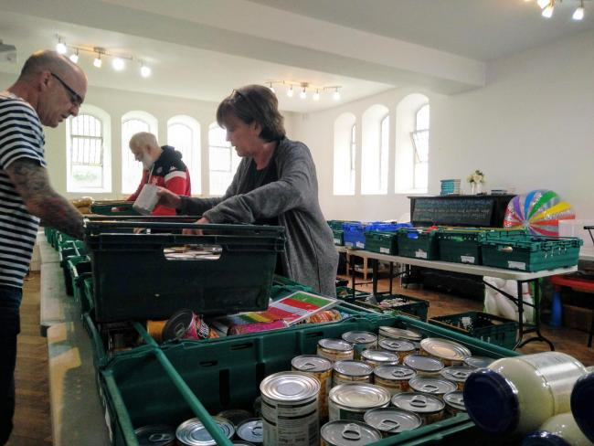Volunteers sort food and essentials at Whitehawk Foodbank