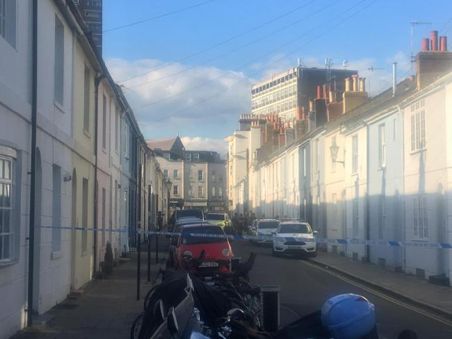 Riot police close off road in Brighton centre to deal with 'domestic incident'