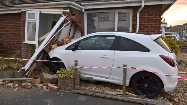 Car crashes into bungalow
