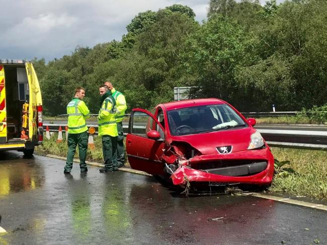 The crash on the M23, with ambulance and police in attendance
