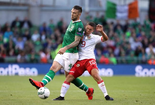 Shane Duffy (left) wins the ball against Gibraltar. Picture PA/Sport
